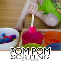 Pom Pom Sorting: a simple toddler activity; fine motor skills for toddlers and preschoolers; early math learning