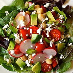 This salad of crunchy radishes, juicy cherry tomatoes, mild green onions, chickpeas, and feta is delicious with or without lettuce.