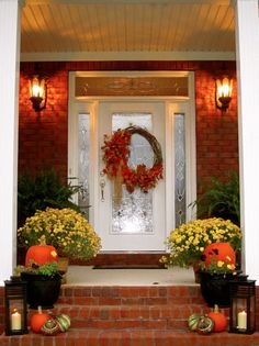 Fall Entryway with wreath, lanterns, mums and pumpkins from There's No Place Like Home: First Impressions
