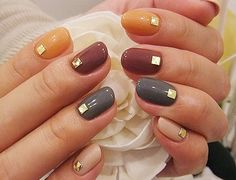 Fall colors and studs. #nailart #fall #polished
