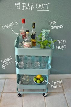 It seems like everyone has a bar cart these days, myself included. When I saw this little turquoise Ikea Raskog kitchen cart I knew that it would make the perfect bar cart for our tiny dinning room. Raskog Ikea, Ikea Raskog Trolley, Drinks Trolley Ikea, Bar Ikea, Ikea Bar Cart, Bar Cart Decor, Bar Carts, Bar Trolley, Storage Trolley