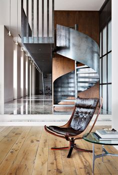 An eye catching display of Masculine interior design in a Moscow penthouse. The steel staircase is softened with it's spiral design and warm timber backdrop. a clever use of form and function. Design Despace, Deco Design, House Design, Interior Stairs, Interior Architecture, Beautiful Architecture, Modern Interior, Interior And Exterior, Masculine Interior