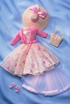 Garden Party™ Fashion  A pretty daytime ensemble, featuring a rose print organza dress, pink chiffon cardigan, straw hat, and straw handbag.