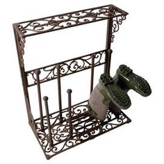 Bring a touch of country style to your home with this cast iron boot rack. Featuring classic detailing and space for 4 pairs of boots, it is perfect in your porch or utility room.     Product: Boot rackConstruction Material: Cast ironColour: IronFeatures:Outdoor boot rackHolds four pairs of bootsDimensions: 76 cm H x 63.5 cm W x 34 cm D
