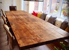 Extending farm house table doubles in size, made from reclaimed warehouse joists.