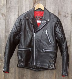 """A Biker classic, a vintage English motorcycle jacket with plenty of character in mint vintage condition with iconic red lining.<br/><br/>Made by TT Leathers one of England's fine leather motorcycle clothing manufacturers. TT Leathers. Motorcycle Jacket. TT Leathers label. (Labelled 38""""). The quality and style, rival other leading English leather producers. 