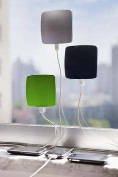 Solar power charger sticks to window to charge your portable device.