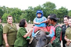 One-of-a-kind buffalo therapy for autistic children in Thailand