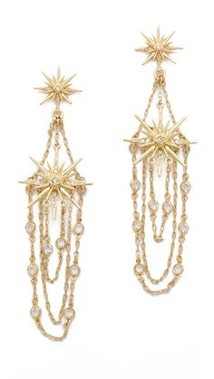 Belle Noel Vintage Glamour Earrings  $95.00  Pavé-set crystals glitter from the slender stars of these Belle Noel earrings, while draped chains lend a soft glimmer. Post closure.