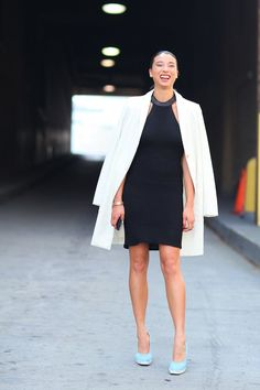 Pin for Later: 30 Ways to Make the Most Out of Your LBD  Cover up the exposed shoulders of a halter dress with an oversize white jacket, and add a hint of color with sky-blue suede pumps.
