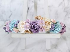 This flower crown is a mix of purple, turquoise blue and cream flowers with a nice touch of gold berries and small accent flowers. >>>>>>>>>>>>>>>>>>>>>>>>>>>>>>>>  MATERIAL: mulberry paper flowers, jute rope.  SIZE: adjustable to fit both kids and adults (tied with flowers).  SHIPPING: from Thailand it takes around 2-4 weeks. See how long it will take to your country here https://www.etsy.com/shop/musefleur?ref=hdr_shop_menu#policies  CANADIAN CUSTOMERS PLEASE NOTE: delay is expected at…