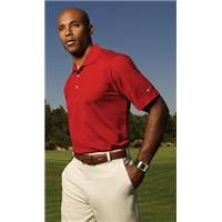 Nike   Dri-Fit UV Textured Sport Shirt    Subtle texture gives this high-performance sport shirt a distinguished advantage. Crafted from Nike Dri-FIT fabric-which is unrivaled in moisture-management technology. Understated vertical texture with a rib-knit collar and three-button placket. The contrast Swoosh design trademark is embroidered on the left sleeve. Pearlized buttons are selected to complement the shirt color. Made of 5.25-ounce, 100% polyester with UPF 30 protection.