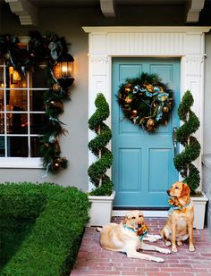 Fun front door color + topiaries. If we do grey/ taupe combo. Brightens it up and a bit different