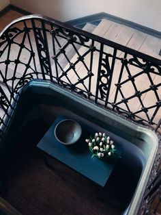 Birds-eye-view of staircase and bowl of tulips