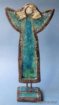 Large angel standing with melted glass. Fireclay ceramic fired at a temperature of about 1000 degrees C.