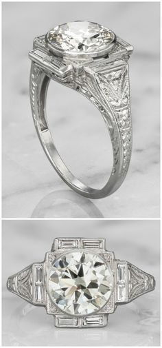 A wonderful Art Deco era vintage engagemnet ring with a 2.23 carat diamond in a platinum bezel setting.