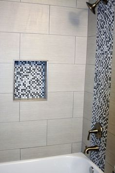 """Bathroom shower with gray and white square mosaic and 12"""" x 24"""" graige tile with light gray grout!"""