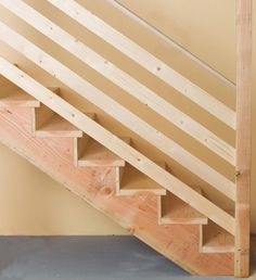 Interesting railing idea for basement stairs. Would look good being stained with the opposite wall being washed brick. How to Build Simple Stairs Nadine Ramke nadineramke Keller / Laundry Interesting railing idea for basement stairs. Diy Stair Railing, Staircase Railings, Stairways, Pipe Railing, Banisters, Modern Staircase, Basement Renovations, Home Remodeling, Basement Designs