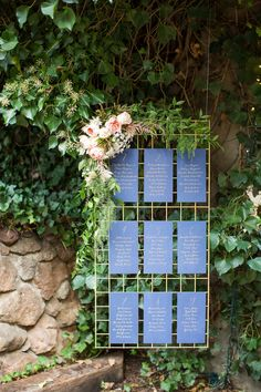 These type of hanging metal grids with floral attached would make a really cool and modern backdrop for the ceremony space rather than doing a traditional 'arch' or fabric backrop.  Still paired with the vases down on the floor/stage level with white florals and lots of candles