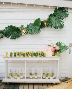 Now THIS is a cocktail bar! /beijosevents/ went all out tropical for their recent boho-holiday bash and we're excited to share it all #onIBTtoday where you'll find all the party inspiration you need! (Link in profile Photo: /kelseyalbright/ Host: @gunnswain Venue: @costa_cabana Florals: /mvflorals/ Signage: /poppyjackshop/ Wine: /onehope/ Cocktail Stirrers: @jennandjulesdesigns)