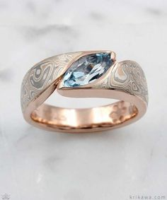 Mokume Wave Engagement Ring with a marquise cut aquamarine! Pictured here in 14k rose gold and our Champagne Mokume Gane. Love the design? Make it your own by customizing it in your favorite metal, mokume and solitaire stone! #gold14knecklace
