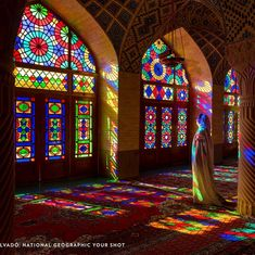 A woman stands basked in the reflections of kaleidoscopic panes of glass in a mosque of Shīrāz, Fars, Iran in this stunning capture by Lluís Salvadó. Glass Wall Art, Fused Glass Art, Stained Glass Art, Stained Glass Windows, Glass Marbles, Glass Beads, Pink Mosque, Wine Bottle Wall, Wine Glass