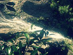 A small waterfall. Water. Landscape. Waterfall. Vegetation. Nature.