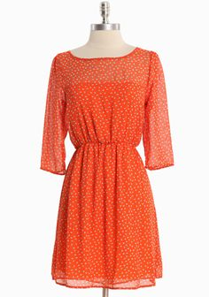 Diminutive apples have fallen onto this delicate red-orange chiffon dress for decidedly whimsical style.
