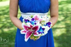 stargazer lilies and orchid wedding bridesmaid bouquet. These are the colors I want for my wedding!