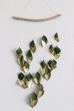 Ditch the tinsel and add some natural shine to your holiday decor with this minimalist gold-leaf wall hanging.