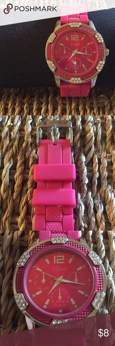 NWOT Vivani pink silicone watch Vivani pink silicone band watch with cubic zirconia detail on face. Displays time, day, and date! OS. Never worn - great condition! NWOT Vivani Accessories Watches