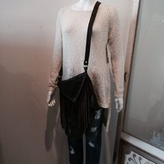 Cute & Cozy awaits you at Palladio. Find this sweater and cross-body combo at Button Up Boutique!
