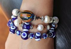 AWESOME BRACELETS!  Lampwork Glass Swirl, Evil Eyes, White Pearls and Silver Accents Leather Bracelets  AyaDesigns - Jewelry on ArtFire