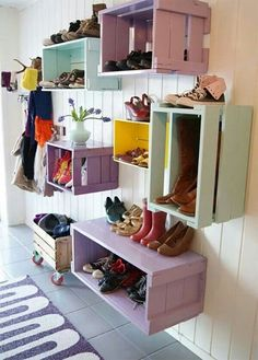 Painted crates hung and used for storage or can be placed on floor