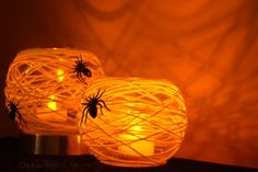 Hot glue yarn and plastic spiders (or googly eyes!) to simple glass votives, and drop a candle in there for a spooky glow.