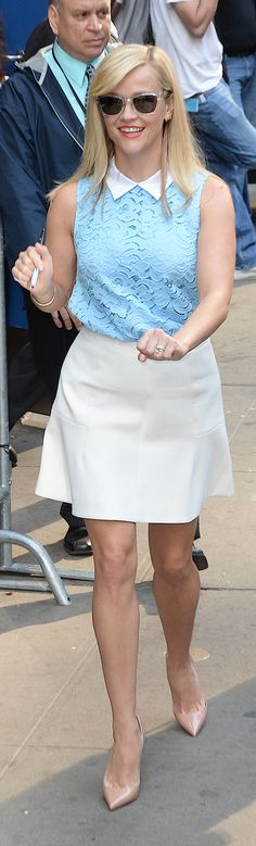 Reese Witherspoon wears a lace collared top from her new brand, Draper James.