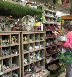 Great way to display miniature and fairy garden items in your store.