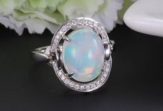 Hey, I found this really awesome Etsy listing at https://www.etsy.com/listing/185566246/opal-engagement-ring-27-carat-opal-019