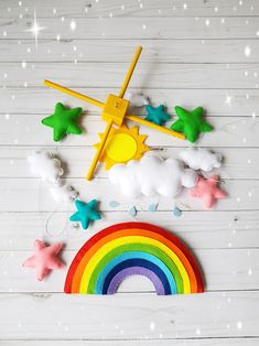 Rainbow colorfull bright crib mobile When you purchase you can choose the color wooden mobile hanger Size -Wooden mobile hanger inches cm) -Rainbow inches cm) -big cloud 6 inches cm) -litlle clouds 3 inches cm) and 2 inches cm) -sun inches cm) -stars and Boy Mobile, Cloud Mobile, Baby Crib Mobile, Baby Cribs, Rainbow Nursery, Rainbow Baby, Colorful Clouds, Baby Boy, Hanging Mobile