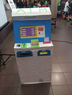 Cardboard ATM machine . When you swap the card then money will come out automatically .