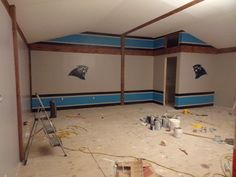 Carolina Panther game room..Used painters tape to help get sharp lines in team colors
