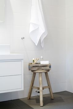 Simple bathroom styling wooden stool