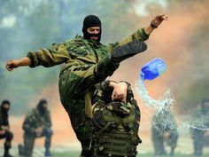 Belarus soldiers of airborne forces perform as they celebrate the Paratroopers' Day in Minsk on Aug. 1, 2015.  Sergei Gapon, AFP/Getty Images