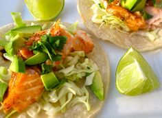 Simple Salmon Tacos with cabbage, avocado, cilantro, lime juice.  ~~~~~~~~~~ {cooking salmon: Preheat the oven to 400°F. In a large baking dish place the salmon fillets. Season with cumin, onion powder, chili powder, garlic powder, salt and pepper. Place the baking dish in the oven and bake for 15 to 20 minutes or until the salmon is cooked through.}