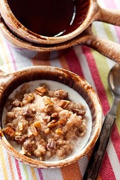 Date Nut Oatmeal - a hearty bowl of oatmeal cooked with dates and pecans, served with brown sugar and cream.