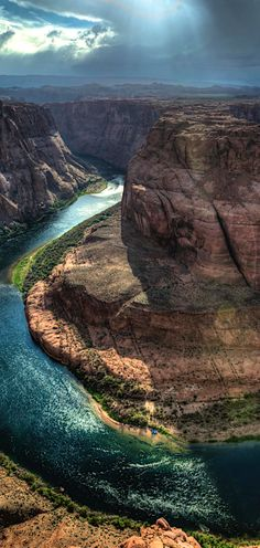 Horseshoe Bend is the name for a horseshoe-shaped meander of the Colorado River located near the town of Page, Arizona, in the United States. It is located 5 miles (8.0 km) downstream from the Glen Canyon Dam and Lake Powell within Glen Canyon National Recreation Area, about 4 miles (6.4 km) southwest of Page. #travel #arizona