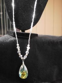 """This is a stunning """"Opera"""" style necklace that measures 26"""" and is simply beautiful.  The neckline has 30 Swavroski crystals displayed with Silver Czech Glass Beads.  Surrounding the Fabulous Crystal pendant is Swavorski Disco Round beads and Swavorski Helix with some Silver Plated spacers making this piece Fabulous.        Please refer your friends and if one of your referrals happens to purchase something from me, I will give you a gift for the referral."""