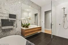 The luxury of the ensuite with its dual vanity basins and dual rain style shower heads...