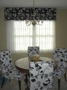 """My client's """"After"""" photo:  This client moved to a retirement community which provided mini blinds and traversing sheers.  To add a little pizzazz we reversed the black on white colors of the chairs to a white on black pattern and mounted a simple cornice at ceiling height"""