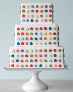 square fondant wedding cake with multi-colored polka dots